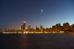 Chicago Night. Chicago cityscape with water in the foreground at night. Clear, open sky. No clouds. Distant moonlight Stock Image