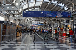 Chicago O Hare Airport. The lifts inside Chicago O´Hare airport in front of Gate C21 and its stores Royalty Free Stock Photo