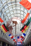 Chicago Ohare International Airport. With various international flags and a metal global hanging from roof, concept for international or global travel or Stock Photos