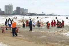 Chicago Polar Plunge 2014. Chicago, IL  - March 2, 2014 - hundreds of brave Chicagoans showed up to jump into the freezing lake Michigan water at the Annual Stock Photos