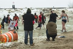 Chicago Polar Plunge. Chicago, IL - March 2, 2014 - hundreds of brave Chicagoans showed up to jump into the freezing lake Michigan water at the Annual Polar royalty free stock photo