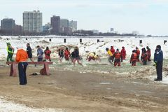 Chicago Polar Plunge. Chicago, IL - March 2, 2014 - hundreds of brave Chicagoans showed up to jump into the freezing lake Michigan water at the Annual Polar royalty free stock images