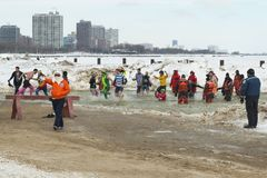 Chicago Polar Plunge. Chicago, IL - March 2, 2014 - hundreds of brave Chicagoans showed up to jump into the freezing lake Michigan water at the Annual Polar stock photo