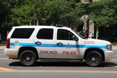 Chicago Police. CHICAGO, UNITED STATES - JUNE 28, 2013: People walk past police car in Chicago. Chicago Police Department is one of oldest police forces in the stock photos