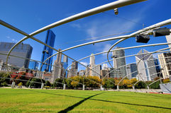 Chicago Pritzker Pavilion featured steel frame. City buildings and Pritzker Pavilion with featured steel frame at Millennium Park in Chicago.  Photo taken in Royalty Free Stock Image