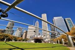 Chicago Pritzker Pavilion field in Millennium Park. City buildings and Pritzker Pavilion at Millennium Park in Chicago.  Photo taken in October 5th, 2014 Royalty Free Stock Photo