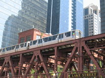 Chicago railroad bridge and train. Chicago architecture from Chicago River, modern office buildings and CTA Metra train Royalty Free Stock Images