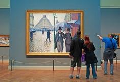 Chicago : regardant le jour pluvieux de rue de Paris de peinture à l'huile par Gustave Caillebotte chez Art Institute de Chicago  Images stock