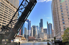 Chicago river and city buildings. City skyscrapers and bridge on Chicago river, Chicago, Illinois, United States.nPhoto taken in October 6th, 2014 Stock Images