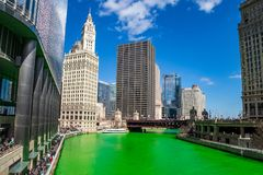 Chicago River dyed green for St. Patty`s Day as crowds gather to party and celebrate. On a cold day stock images