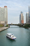 Chicago River Ferry. Tour boat on the Chicago river from Lake Michigan, between skyscrapers. Vertical format Royalty Free Stock Photos