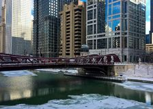 Chicago River is frozen and reflecting bridge over it on frigid winter afternoon. Chicago River is frozen and reflecting bridge over it on frigid winter stock photos