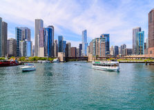 Chicago River and Skyline. Chicago, USA - May 24, 2014: Different kinds of boats on Chicago River in front of Chicago skyline Stock Photo
