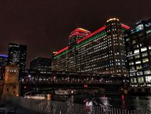 Chicago`s el train passes through the city, illuminated with Christmas holiday decorations. Royalty Free Stock Photography
