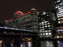 Chicago`s el train passes through an illuminated cityscape with Christmas holiday decorations. Royalty Free Stock Photography