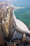 Chicago's Lake Shore Drive In Winter. Lake Michigan and high rises in the wintertime with Lake Shore Drive in backgroud Stock Photography