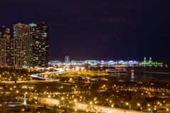 Chicago's Lakeshore at Night. A view of Chicago's Lakeshore Drive, Grant Park, and the Navy Pier at night royalty free stock image