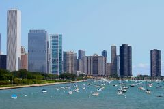 Chicago Shoreline. This summer photo reveals many boats lined up in the waters along the architecture of Chicago. Blue sky and the aqua colored lake make this an royalty free stock photo