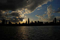 Chicago silhouette. Beautiful sunset photo of Chicago along with Lake Michigan. Chicago gives perfect sunset photos because sun goes down right behind the city stock photography