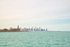 Chicago skyline as seen from south side lakeshore of Lake Michigan on a frigid winter day. Chicago skyline as seen from south side lakeshore of brilliant aqua royalty free stock photography