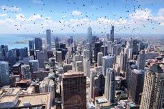Chicago skyline. Chicago city skyline with Lake Michigan. Ominous birds stock photos
