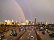 Chicago Skyline with a Double Rainbow. Two rainbows appear to end at Chicago`s Loop. A view of the skyline and Kennedy Expressway traffic royalty free stock photography