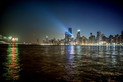 Chicago skyline with a light beam and fireworks at night stock photography