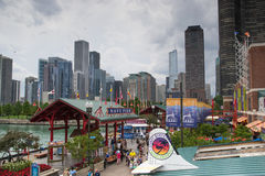 Chicago skyline by navy pier. Chicago,USA-august 12,2013:Navy Pier is in the heart of downtown Chicago on the shore of Lake Michigan in a cloudy day. It's a huge Stock Image