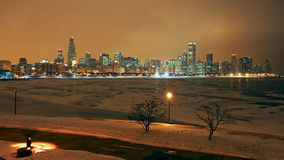 Chicago skyline at night with snow Stock Images