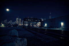 Chicago skyline at night with train tracks leading into the city Royalty Free Stock Photo