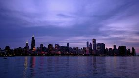 Chicago skyline reflected on the lake at sunset time lapse