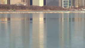 Chicago skyline reflecting on ice stock video