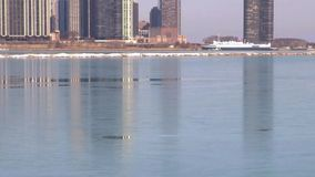 Chicago skyline reflecting on ice stock footage