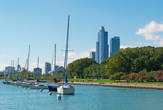 Chicago skyline with sailboats and speedboats in the park district, dock and pier of Michigan Lake shoreline Royalty Free Stock Images