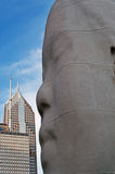 Chicago: skyline and the sculpture 1004 Portraits by Jaume Plensa in Millennium Park on September 23, 2014. Chicago, Illinois, United States of America, Usa royalty free stock photo
