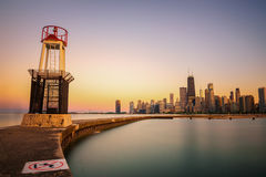 Chicago skyline at sunset viewed from North Avenue Beach. CHICAGO, ILLINOIS, USA - MAY 30, 2016 : Chicago skyline across Lake Michigan at sunset viewed from Stock Images
