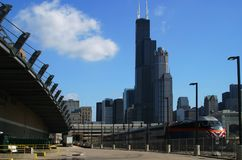 Chicago Skyline with Train. A city train in foreground of skyline in Chicago Royalty Free Stock Image