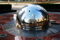 Chicago Skyline, USA. Chicago skyline and skyscrapers reflected in stainless steel half sphere in non-operating fountain, Illinois, USA royalty free stock photography