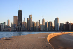 Chicago Skyline view along Lake Michigan close to. Chicago skyline view from the pier along Lake Michigan at sunset Royalty Free Stock Image