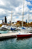 Chicago skyline view from Burnham Harbor with docked boats Stock Image