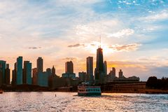 Chicago skyline viewed from the pier on Lake Michigan with sunset sky in the background stock images