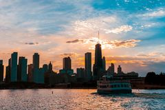 Chicago skyline viewed from the pier on Lake Michigan with sunset sky in the background stock photo