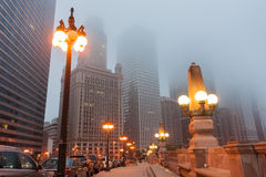 Chicago street as mist descends and lights come on Upper Wacker Stock Image