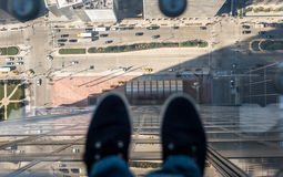 Chicago streets under the feet. Chicago streets below the feet point of view through glass floor Stock Images