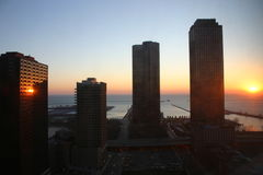 Chicago sunrise. Chicago USA. Sunrise over Lake Michigan. Sunlight reflecting off the lake and a skyscraper Royalty Free Stock Photos