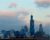 Chicago sunset. Setting winter sun reflected on the sears towers Royalty Free Stock Image