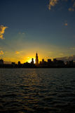 Chicago sunset. Beautiful portrait afternoon scene of Chicago along with Lake Michigan. Chicago gives perfect sunset photos because sun goes down right behind stock photo