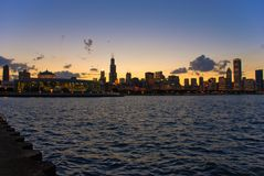 Chicago sunset. Beautiful afternoon scene of Chicago with lights on along with Lake Michigan. Chicago gives perfect sunset photos because sun goes down right Stock Photography