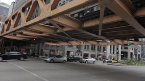Chicago train crossing over a street 1080p. Chicago train crossing over a street hd stock video
