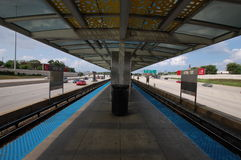 Chicago transit. Authority train line flanked by highway Royalty Free Stock Images